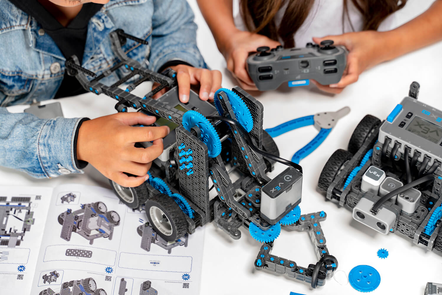 Kids at desk with VEX IQ Robot