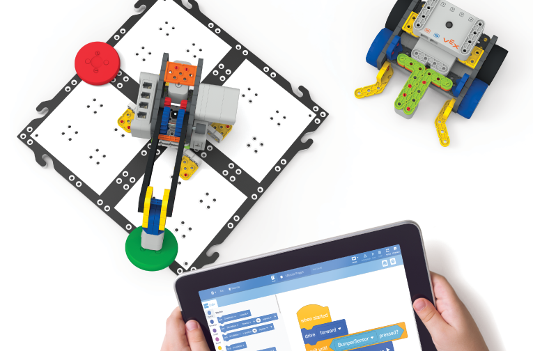 Vex go robots being coded with Vexcode blocks on an ipad