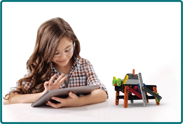 elementary school age girl coding on an ipad next to a Vex Go robot